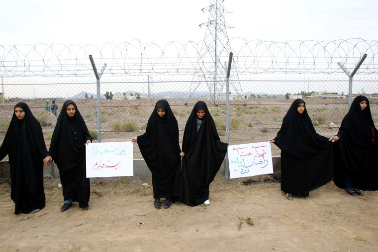 Iranian students form a human chain during a protest to defend their country's nuclear program outside the Fordo Uranium Conversion Facility in Qom, Nov. 19, 2013.