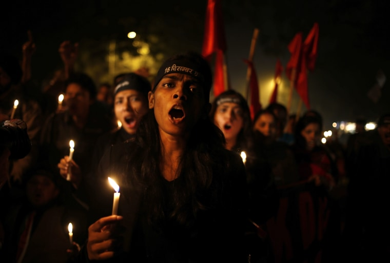 Indians take out a candle light vigil on the first anniversary of the brutal rape and murder of a young student in New Delhi, India, Dec. 16, 2013.