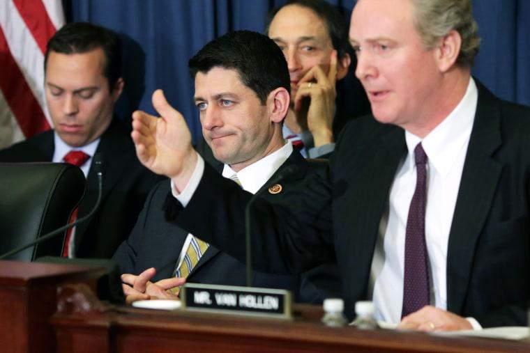 Paul Ryan listens to Rep. Chris Van Hollen speak before the House Budget Committee on Capitol Hill, Feb. 5, 2014.