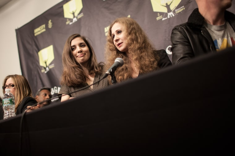 Nadezhda Tolokonnikova (L) and Maria Alyokhina (R), members of the Russian punk group Pussy Riot, at a press conference in Brooklyn, N.Y. on Feb. 5, 2014.