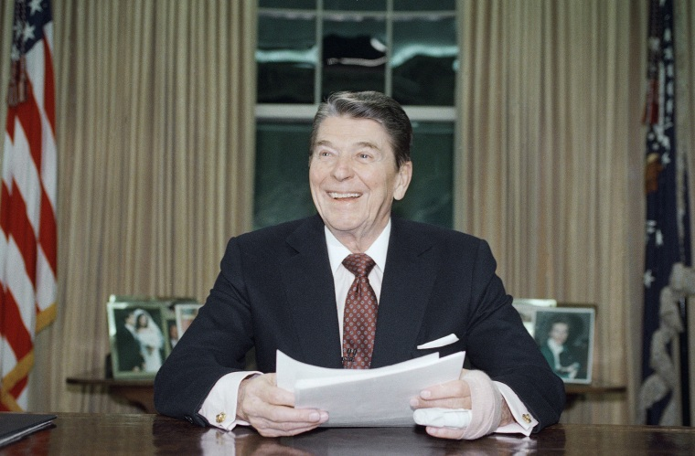 President Ronald Reagan poses for photographers in the Oval Office, Jan. 11, 1989 after delivering a televised farewell address to the nation.