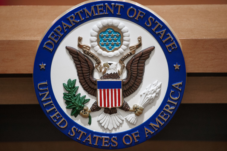 The US Department of State seal is seen Nov. 26, 2013 in the State Department briefing room in Washington, DC.