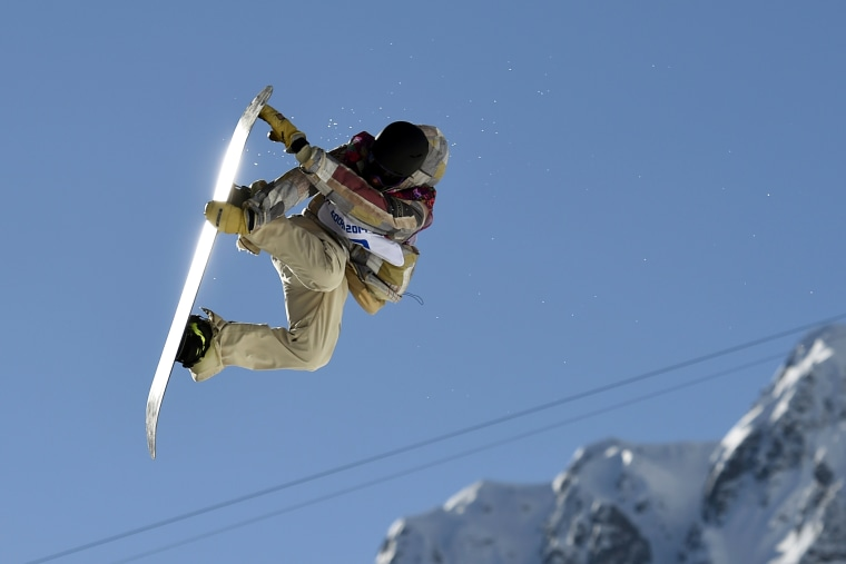 Sage Kotsenburg of the United States performs a jump during the men's snowboard slopestyle final at the 2014 Sochi Olympic Games, Feb. 8, 2014, in Rosa Khutor.