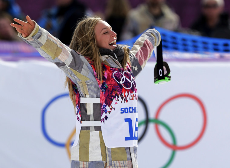 American Jamie Anderson celebrates after winning the women's snowboard slopestyle final at the 2014 Winter Olympics, Feb. 9, 2014, in Krasnaya Polyana, Russia.