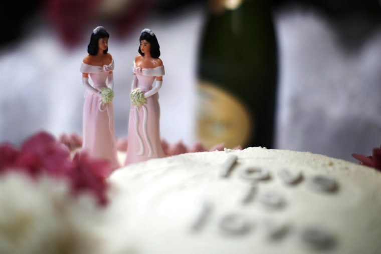 A wedding cake is seen at a reception for same-sex couples.