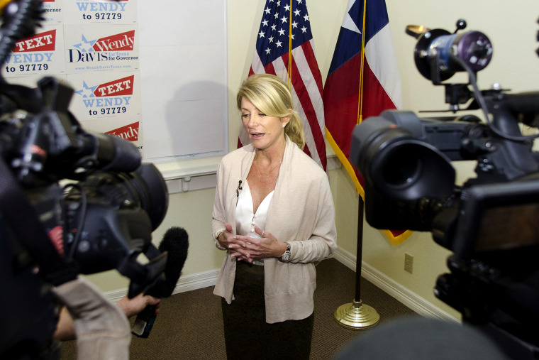 Texas Democrat State Senator Wendy Davis answers media questions during the opening of her gubernatorial campaign headquarters in Fort Worth, Texas, Dec. 14, 2013.
