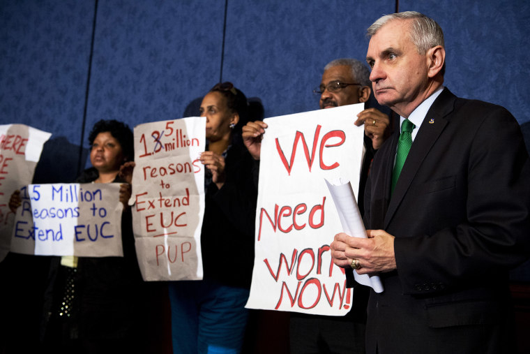 Sen. Jack Reed stands with unemployed Americans during a news conference in the Capitol Visitor Center to urge Congress to extend unemployment benefits, Jan. 16, 2014.