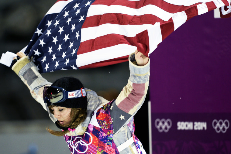 Gold Medallist, US Kaitlyn Farrington, celebrates at the end of the Women's Snowboard Halfpipe Final, Feb. 12, 2014.