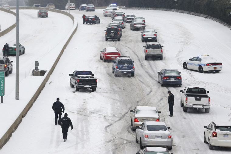 Police Officers work to assist motorists in Charlotte, North Carolina, Feb. 12, 2014.