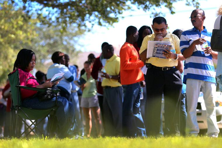 People wait in line to vote at the North Miami Public Library on Nov. 1, 2012 in North Miami, Fl.