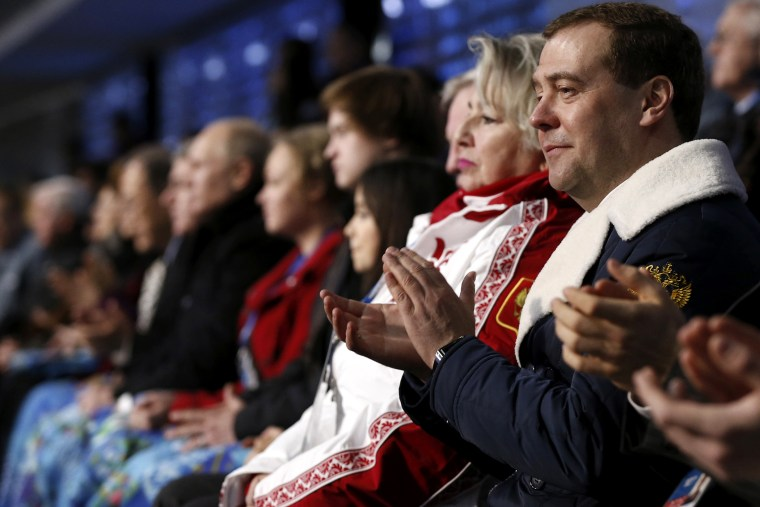 Russia's Prime Minister Dmitry Medvedev (R) attends the opening ceremony of the 2014 Sochi Winter Olympics, Feb. 7, 2014