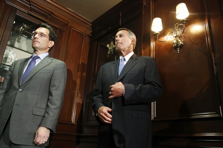 U.S. House Majority Leader Eric Cantor (R-VA) (L) and House Speaker John Boehner (R-OH) (R) stand together at a news conference, Oct. 23, 2013, in Washington.