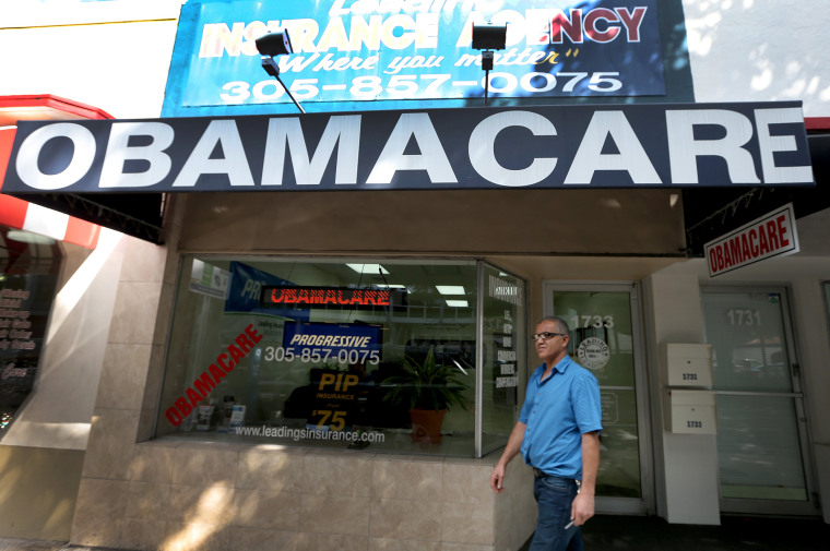 Hisham Uadadeh walks out of Leading Insurance Agency after  enrolling in a health insurance plan under the Affordable Care Act on February 13, 2014 in Miami, Florida.