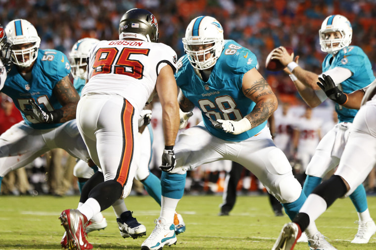 Richie Incognito #68 of the Miami Dolphins battles Gary Gibson #95 of the Tampa Bay Buccaneers during a preseason game, Aug. 24, 2013.