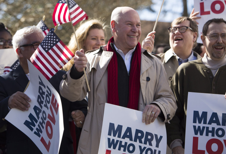 Robert Roman and Claus Ihlemann of Virginia Beach celebrate with Carol Schall, Mary Townley , Tim Bostic and Tony London, Thursday's ruling that Virginia's same-sex marriage ban was unconstitutional.