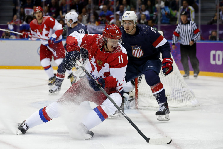 Russia's Yevgeni Malkin (L) spins away from Team USA's Ryan McDonagh during the first period of their men's preliminary round ice hockey game, Feb. 15, 2014, in Sochi, Russia.