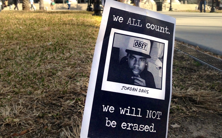 Small memorials to Jordan Davis, that were quickly removed,  are planted outside the courthouse in Jacksonville, Fla., Tuesday Feb. 4, 2014.  It is the...