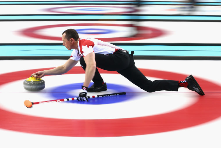 E.J. Harnden of Canada in action during a round robin curling match against Germany during day 3 of the Sochi 2014 Winter Olympics at Ice Cube Curling Center on Feb. 10, 2014 in Sochi, Russia.
