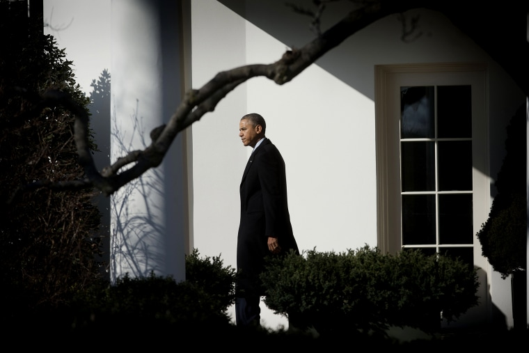 President Barack Obama walks out of the Oval Office of the White House in Washington, Feb. 7, 2014.
