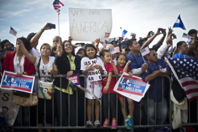 Immigration reform supporters cheer at a rally on the National Mall in Washington, Oct. 8, 2013.