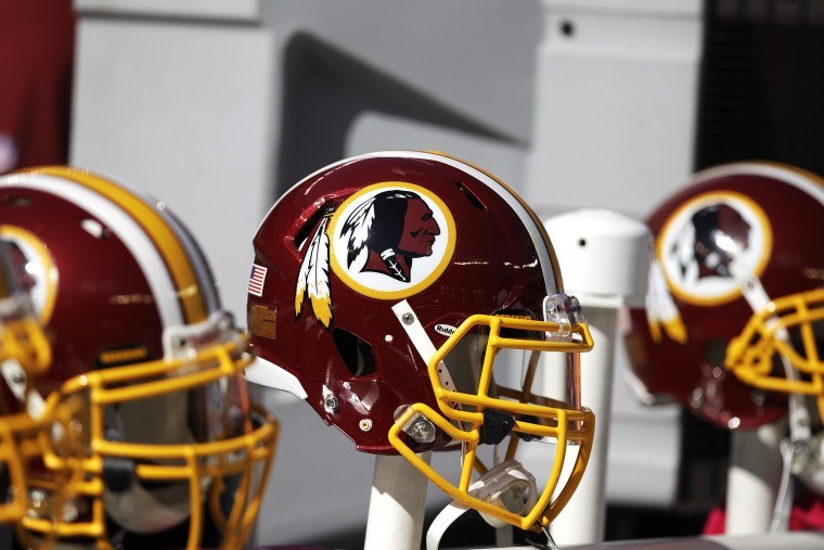 In this Oct. 21, 2012 file photo, Washington Redskins helmets are shown during the first half of an NFL football game in East Rutherford, N.J.