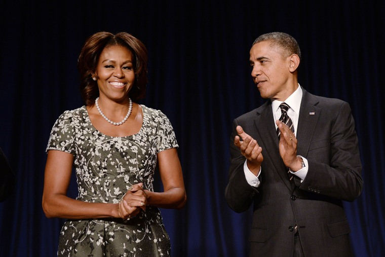 U.S. President Barack Obama and first lady Michelle Obama attend the National Prayer Breakfast in Washington, Feb. 6, 2014.