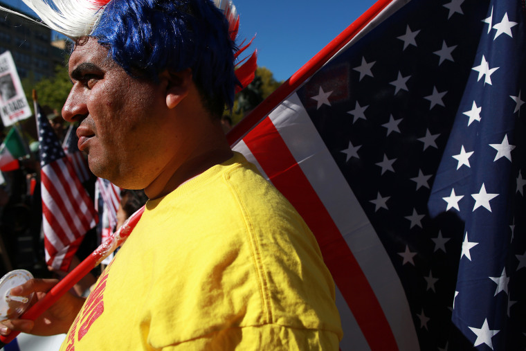 A protestor wearing a red, white and blue mohawk wig, rallies with civil liberties, immigrant rights and equality groups that attended a May Day protest at in New York City on May 1, 2013.