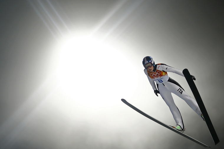Italy's Evelyn Insam soars through the air in her trial jump during the women's ski jumping individual normal hill event of the Sochi 2014 Winter Olympic Games, at the RusSki Gorki Ski Jumping Center in Rosa Khutor, February 11, 2014.