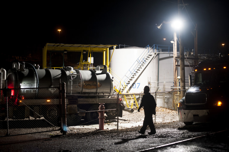 Emergency crews worked throughout the night cleaning up a chemical leak from a tank at the West Virginia American Water Plant on the Elk River, Jan. 11, 2014.