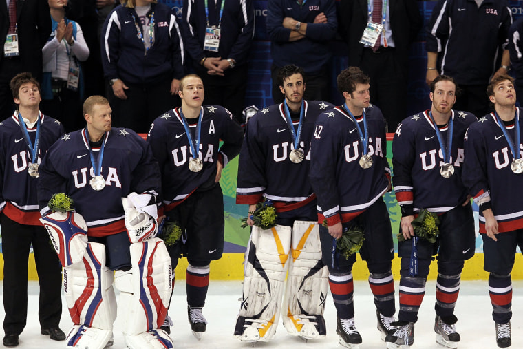 Members of the USA hockey team look on dejectedly after receiving their silver medals following their 3-2 overtime loss to Canada, Feb. 28, 2010.