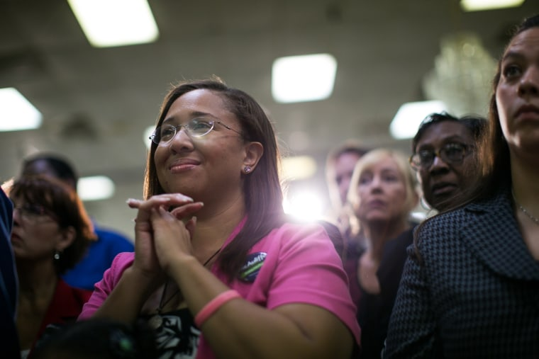 Supporters of Virginia Governor Terry McAuliffe listen during a campaign event in Dale City, Va., Oct. 27, 2013.
