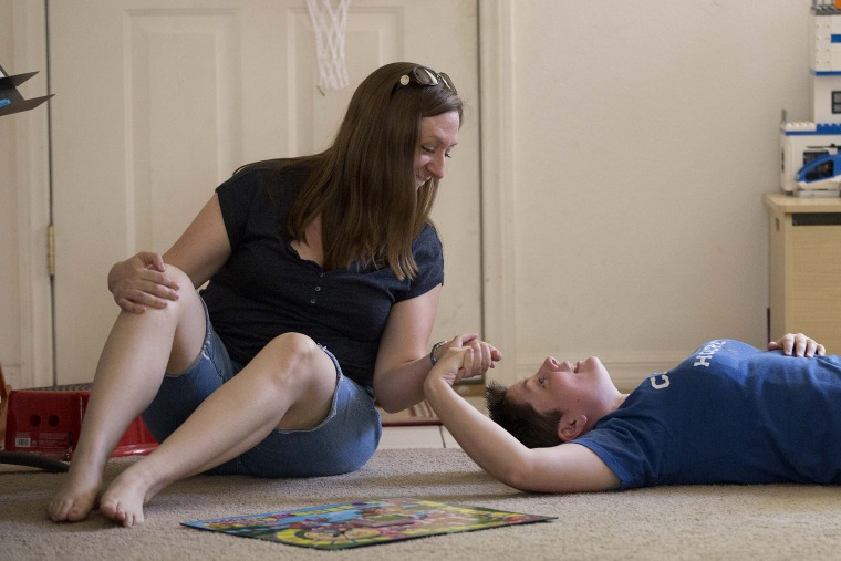Megan Lanz, left, and her partner, Sara Geiger, take a break from playing with their 3-year-old daughter Jordan (not pictured) at their home, Sunday, April 29, 2012, in Las Vegas.
