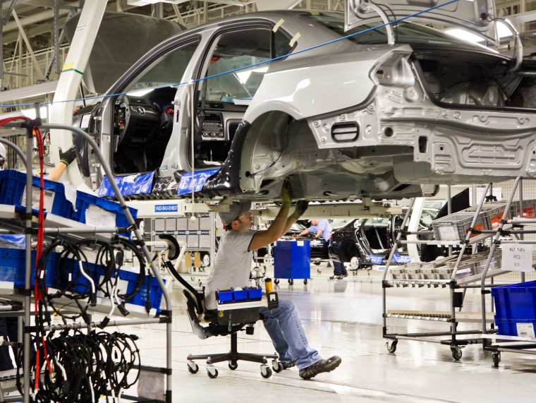 In this July 31, 2012, file photo, an employee works on a Passat sedan at the Volkswagen plant in Chattanooga, Tenn.