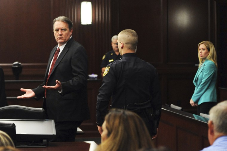 Michael Dunn raises his hands in disbelief as he looks at his parents after the verdicts were announced in his trial in Jacksonville, Florida Feb. 15, 2014.