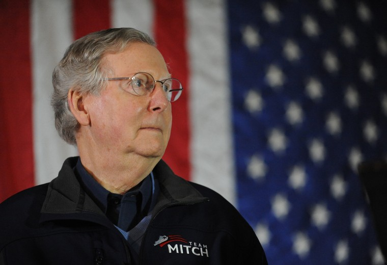 Sen. Mitch McConnell, R-Ky., waits to speak during a campaign stop at Badgett Supply in Madisonville, Ky., Saturday, Feb. 8, 2014.