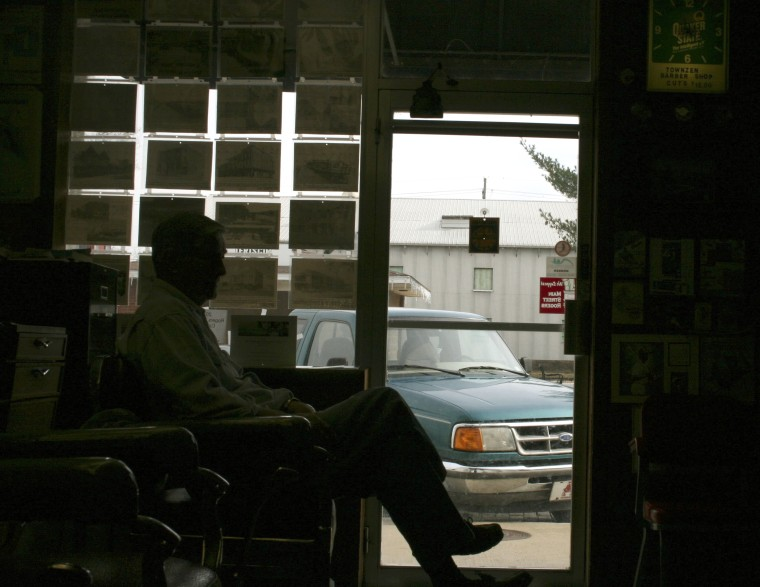 Ray Sanford awaits a haircut in a barbershop in downtown Rogers, Arkansas, December 4, 2013.