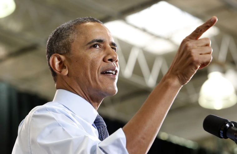 U.S. President Barack Obama delivers remarks on the economy at Costco Wholesale in Woodmore Towne Centre in Lanham, Maryland January 29, 2014.