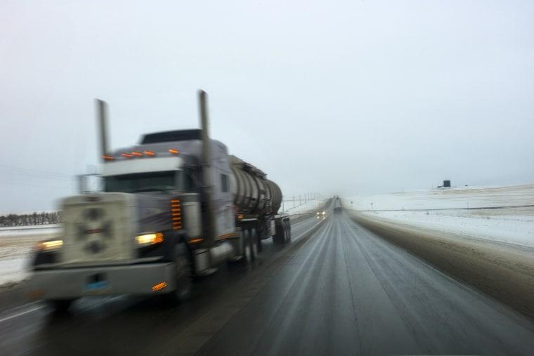An oil tanker drives down a road near Watford City, North Dakota.