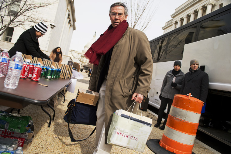 Rep. Rush Holt prepares to board a bus for the House Democrats' retreat in Cambridge, Md., Feb. 14, 2014.
