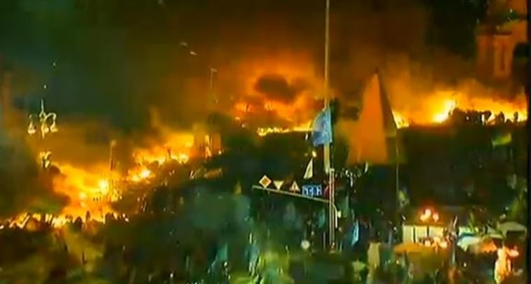 Flames engulf Independence Square where riot police clash with protesters in Kiev, Ukraine.