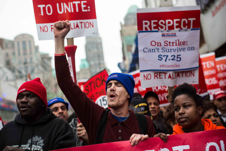 Protesters rally outside of a Brooklyn Wendy's in support of raising fast food wages from $7.25 per hour to $15.00 per hour, Dec. 5, 2013.