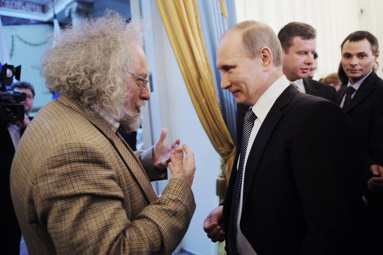 Russia's Prime Minister Vladimir Putin speaks with Ekho Moskvy radio editor-in-chief Alexei Venediktov during an awarding ceremony in Moscow, Jan. 13, 2012.