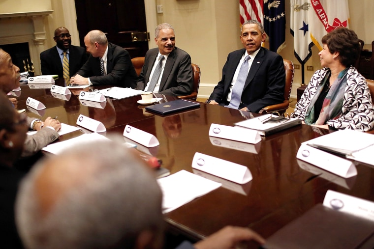President Barack Obama (2nd R), Attorney General Eric Holder (C) and Senior Advisor to the President Valerie Jarrett (R) meet with leaders from African American civil rights groups an the White House Feb. 18, 2014 in Washington, DC.