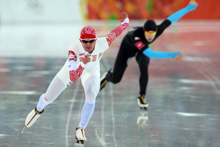 Russia's Yevgeny Seryayev (L) and US Emery Lehman compete in the Men's Speed Skating 10000m, Feb. 18, 2014.