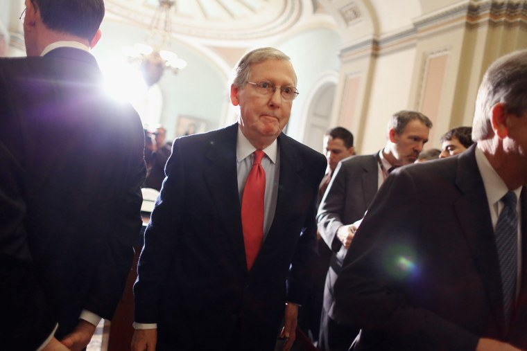 Mitch McConnell leaves after talking with reporters at the U.S. Capitol, Jan. 28, 2014.