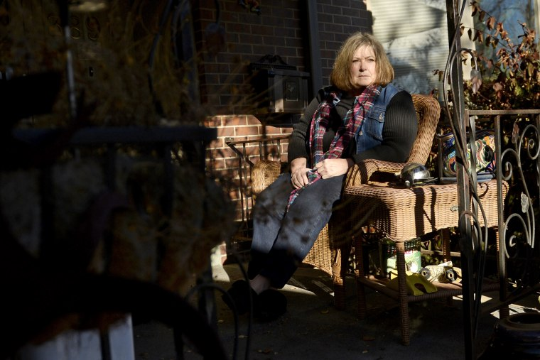 Kim Sayers, seen outside her home in Denver, faced losing her unemployment insurance benefits in December, 2013.