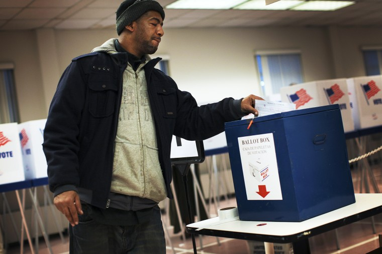 A voter drops off a provisional ballot at the Board of Elections in downtown Cleveland, on Election Day Nov. 6, 2012.