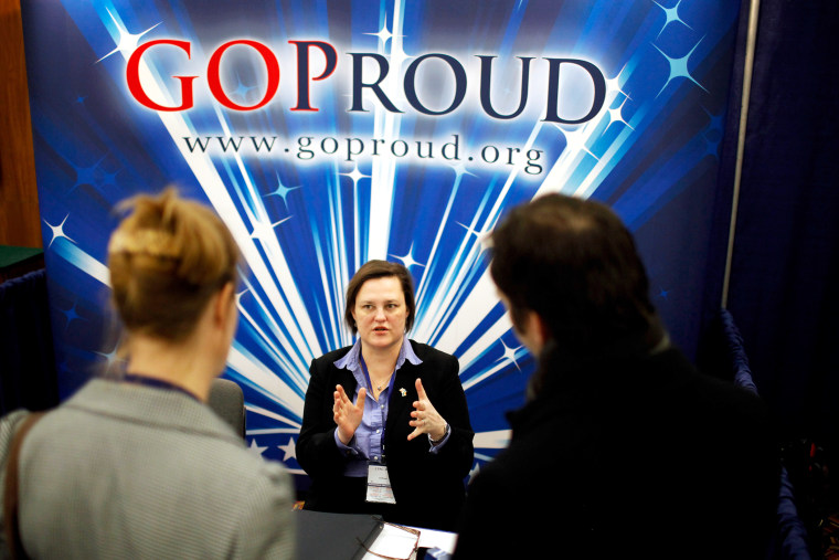Participants talk with a representatives from GOProud, an organization that represents gay conservatives and their allies, at the 2011 CPAC in Washington, DC.