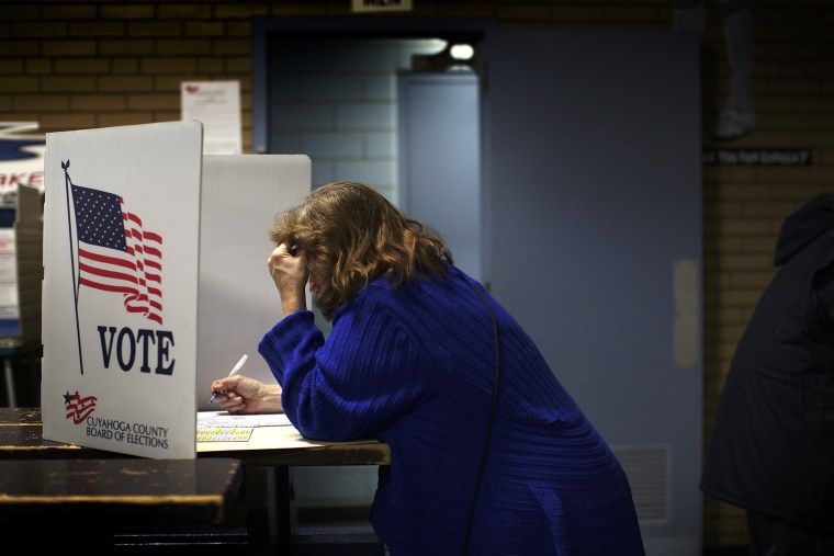 Deborah Carr, votes before heading to work a night shift, in Cleveland, Ohio on Nov. 6, 2012.