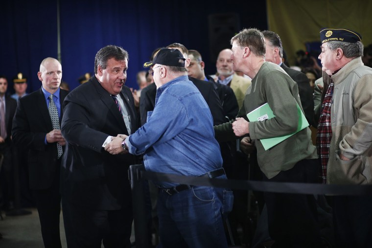 New Jersey Governor Chris Christie shakes hands with guests as he attends the 110th Town Hall Meeting in Middletown Township, on Feb. 20, 2014.